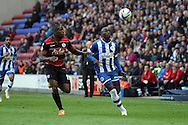 Wigan Athletic's Marc-Antoine Fortune battles with Queens Park Rangers Nedum Onuoha (l). Skybet football league championship play off semi final, 1st leg match, Wigan Athletic v QPR at the DW Stadium in Wigan, England on Friday 9th May 2014.pic by Chris Stading, Andrew Orchard sports photography.