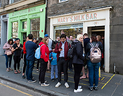 Queue of people outside Mary's Milk Bar on Grassmarket in Edinburgh Old Town, Scotland, UK