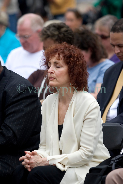 01January, 2006. New Orleans, Louisiana.  Post Katrina aftermath.<br /> New Year's Day in New Orleans, Louisiana. Louisiana Rebirth interfaith service at the Superdome rings out the old disastrous 2005 and rings in what politicians and locals hope will be a successful 2006. TV soap opera star Robin Strasser (l) of 'One Life to Live' fame prays at the service.<br /> Photo; ©Charlie Varley/varleypix.com