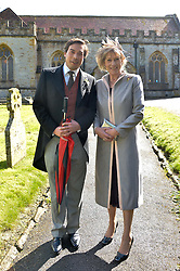 IAIN RUSSELL and LADY TOLLEMACHE mother of The Groom at the wedding of Princess Florence von Preussen second daughter of Prince Nicholas von Preussen to the Hon.James Tollemache youngest son of the 5th Lord Tollemache held at the Church of St.Michael & All Angels, East Coker, Somerset on 10th May 2014.