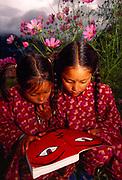 Sisters read Nepal guide book, Simikot, Western Nepal