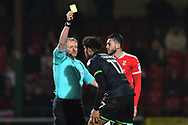 Yellow Card - Omar Sowunmi (17) of Yeovil Town is shown a yellow card, booked by referee Trevor Kettle for a foul on James Dunne (8) of Swindon Town during the EFL Sky Bet League 2 match between Swindon Town and Yeovil Town at the County Ground, Swindon, England on 10 April 2018. Picture by Graham Hunt.