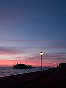 A colourful sunset over Walvis Bay coastline and pier, Namibia