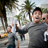"Tunis, Tunisia 16 October 2011<br /> An ""agent provocateur"" is arrested by a policeman while Tunisians where demonstrating for peace, freedom of speech and a secular state.<br /> An election for a Constituent Assembly will be held in Tunisia on 23 October 2011, following the Tunisian Revolution.<br /> Photo: Ezequiel Scagnetti"