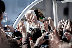 Vatican, Italy - Feb 27, 2013 - Pope Benedict XVI attends his final General Audience at the Vatican before his resignation. Thousands of faithful gathered in St. Peter's Square to greet the Pope.