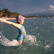 A young girl enjoy's the pristine waters of White Beach, Boracay Island, the Philippines on October 1, 2008, Photo Tim Clayton..Asian tourists at White Beach, Boracay Island, the Philippines...The 4 km stretch of White beach on Boracay Island, the Philippines has been honoured as the best leisure destination in Asia beating popular destinations such as Bali in Indonesia and Sanya in China in a recent survey conducted by an International Travel Magazine with 2.2 million viewers taking part in the online poll...Last year, close to 600,000 visitors visited Boracay with South Korea providing 128,909 visitors followed by Japan, 35,294, USA, 13,362 and China 12,720...A popular destination for South Korean divers and honeymooners, Boracay is now attracting crowds of tourists from mainland China who are arriving in ever increasing numbers. In Asia, China has already overtaken Japan to become the largest source of outland travelers...Boracay's main attraction is 4 km of pristine powder fine white sand and the crystal clear azure water making it a popular destination for Scuba diving with nearly 20 dive centers along White beach. The stretch of shady palm trees separate the beach from the line of hotels, restaurants, bars and cafes. It's pulsating nightlife with the friendly locals make it increasingly popular with the asian tourists...The Boracay sailing boats provide endless tourist entertainment, particularly during the amazing sunsets when the silhouetted sails provide picture postcard scenes along the shoreline...Boracay Island is situated an hours flight from Manila and it's close proximity to South Korea, China, Taiwan and Japan means it is a growing destination for Asian tourists... By 2010, the island of Boracay expects to have 1,000,000 visitors.