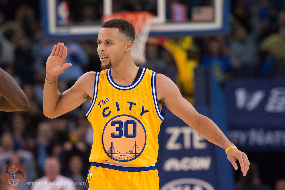 November 17, 2015; Oakland, CA, USA; Golden State Warriors guard Stephen Curry (30) celebrates during the fourth quarter against the Toronto Raptors at Oracle Arena. The Warriors defeated the Raptors 115-110.