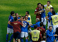 Photo: Glyn Thomas.<br />Italy v Australia. 2nd Round, FIFA World Cup 2006. 26/06/2006.<br /> Italy's Francesco Totti (fourth from L) is mobbed by his teammates after scoring his side's last-minute penalty.