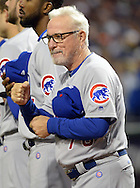 CLEVELAND, OH - OCTOBER 25: Manager Joe Maddon of the Chicago Cubs motions to Terry Francona after the National Anthem prior to Game 1 of the 2016 World Series versus the Cleveland Indians at Progressive Field on Tuesday, October 25, 2016 in Cleveland, Ohio. (Photo by Ron Vesely/MLB Photos via Getty Images)