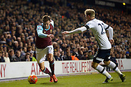 Carl Jenkinson of West Ham United goes past Christian Eriksen of Tottenham Hotspur . Barclays Premier league match, Tottenham Hotspur v West Ham Utd at White Hart Lane in London on Sunday 22nd November 2015.<br /> pic by John Patrick Fletcher, Andrew Orchard sports photography.