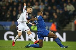 Burnley's Johann Berg Gudmundsson has a shot on goal under pressure from Leicester City's Wes Morgan