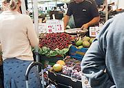 People browsing market stalls, Devizes, Wiltshire, England, UK