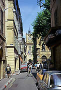 Historic buildings in street city centre of Aix-en-Provence, France 1974 with tower of city hall ahead