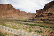 SHOT 5/7/16 8:38:33 AM - Moab is a city in Grand County, in eastern Utah, in the western United States. Moab attracts a large number of tourists every year, mostly visitors to the nearby Arches and Canyonlands National Parks. The town is a popular base for mountain bikers and motorized offload enthusiasts who ride the extensive network of trails in the area. Includes images of Scenic Byway 128, Fisher Towers and downtown Moab. (Photo by Marc Piscotty / © 2016)