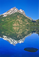 Reflections of the Cathedral Group in Genny Lake.  Grand Teton National Park,summer, Wyoming, USA
