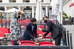 © Licensed to London News Pictures. 10/04/2021. London, UK. With less than two day to go, restaurant staff prepare tables and chairs for outside dining for the big opening on Monday12th. Prime Minister Boris Johnson announced last week that non-essential shop, restaurants with outside seating, hairdressers and gyms can reopen on Monday 12 April 2021 after 4 months of Covid-19 lockdowns. Photo credit: Alex Lentati/LNP