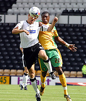 Photo: Dave Linney.<br />Derby County v Norwich City. Coca Cola Championship. 19/08/2006Norwich's.Dickson Etuhu(R) challenges   Morten Bisgaard for the ball