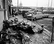 On the morning of 2nd December two car bombs exploded in Dublin City. At Sackville Place, busmen George Bradshaw (30) and Thomas Duffy (230 were killed as they waited in their car to resume work. The bomb was thought to be planted by a Northern Ireland subversive group who hoped to influence legislation going through Dail Eireann in relation to the IRA. The remains of the car used as the bomb vehicle lie scattered on the pavement along Eden Quay. <br /> 02/12/1972