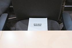 """14.03.2020, Hofburg, Wien, AUT, Parlament, Pressestatement Nationalratspraesident Wolfgang Sobotka berichtet im Vorfeld der heutigen außerplanmaessigen Nationalratssitzung über das parlamentarische Prozedere, das mit den dringlichen Massnahmen der Bundesregierung und der Aufrechterhaltung der Handlungsfaehigkeit des oesterreichischen Parlaments im Zusammenhang mit dem Coronavirus stehen, im Bild Zettel """"Bitte nicht benuetzen"""" auf jedem zweiten Sessel im Zuge des Coronavirus // during press statement In the run-up to today's unscheduled National Council meeting, National Council President Wolfgang Sobotka reports on the parliamentary procedure related to the urgent measures of the Federal Government and the maintenance of the Austrian Parliament's ability to act in connection with the corona virus at Hofburg palace in Vienna, Austria on 2020/02/27, EXPA Pictures © 2020, PhotoCredit: EXPA/ Florian Schroetter"""