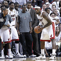 21 June 2012: Miami Heat power forward Juwan Howard (5) cheers Miami Heat small forward LeBron James (6) during the Miami Heat 121-106 victory over the Oklahoma City Thunder, in Game 5 of the 2012 NBA Finals, at the AmericanAirlinesArena, Miami, Florida, USA. The Miami Heat wins the series 4-1.
