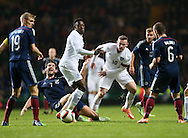 Scotland's Charlie Mulgrew tussles with England's Danny Welbeck and Wayne Rooney<br /> <br /> - International Friendly - Scotland vs England- Celtic Park - Glasgow - Scotland - 18th November 2014  - Picture David Klein/Sportimage