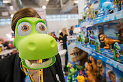 A childrens mask from Disneys the Good Dinosaauron the Tomy stand - The annual London Toy Fair, the trade show for the toy and games industry, takes place at Olympia.