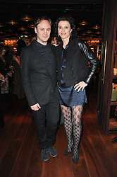 NICHOLAS KIRKWOOD and EVA ZEIGLER Global CEO of W Hotels at a dinner in honour of Andre Leon Talley and Manolo Blahnik held at The Spice Market restaurant at W London, Leicester Square, London on 14th March 2011.