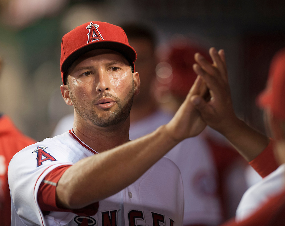 The Angels' Huston Street gets a high five after pitching in the ninth inning during the Angels' 6-1 loss to the Chicago Cubs Tuesday at Angel Stadium.<br /> <br /> ///ADDITIONAL INFO:   <br /> <br /> angels.0406.kjs  ---  Photo by KEVIN SULLIVAN / Orange County Register  --  4/5/16<br /> <br /> The Los Angeles Angels take on the Chicago Cubs Tuesday at Angel Stadium.<br /> <br /> <br />  4/5/16