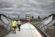 View looking across Millennium Bridge towards St Pauls Cathedral is eerily quiet and silent aside from a few pedestrians and runners on empty streets as lockdown continues and people observe the stay at home message in the capital on 11th May 2020 in London, England, United Kingdom. Coronavirus or Covid-19 is a new respiratory illness that has not previously been seen in humans. While much or Europe has been placed into lockdown, the UK government has now announced a slight relaxation of the stringent rules as part of their long term strategy, and in particular social distancing.