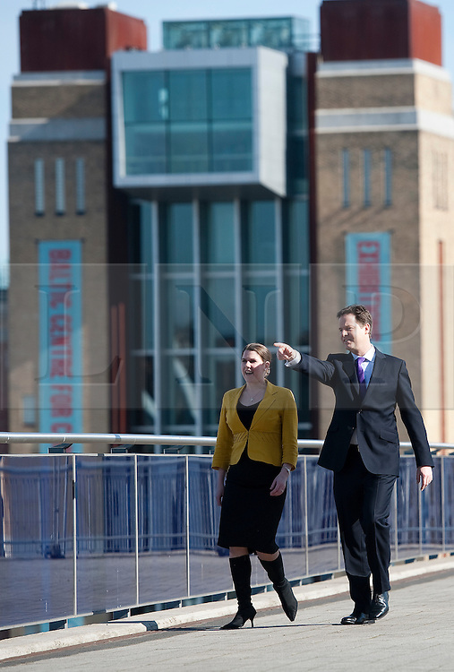 © London News Pictures. 11/03/2012.  Gateshead, UK. Member of Parliament for East Dunbarton JO SWINSON and Leader of the Liberal Democrats NICK CLEGG walking in front of the Baltic Centre for Arts as they enter the Liberal Democrat Spring conference at the Sage Gateshead on March 11th, 2012. Photo credit : Ben Cawthra/LNP
