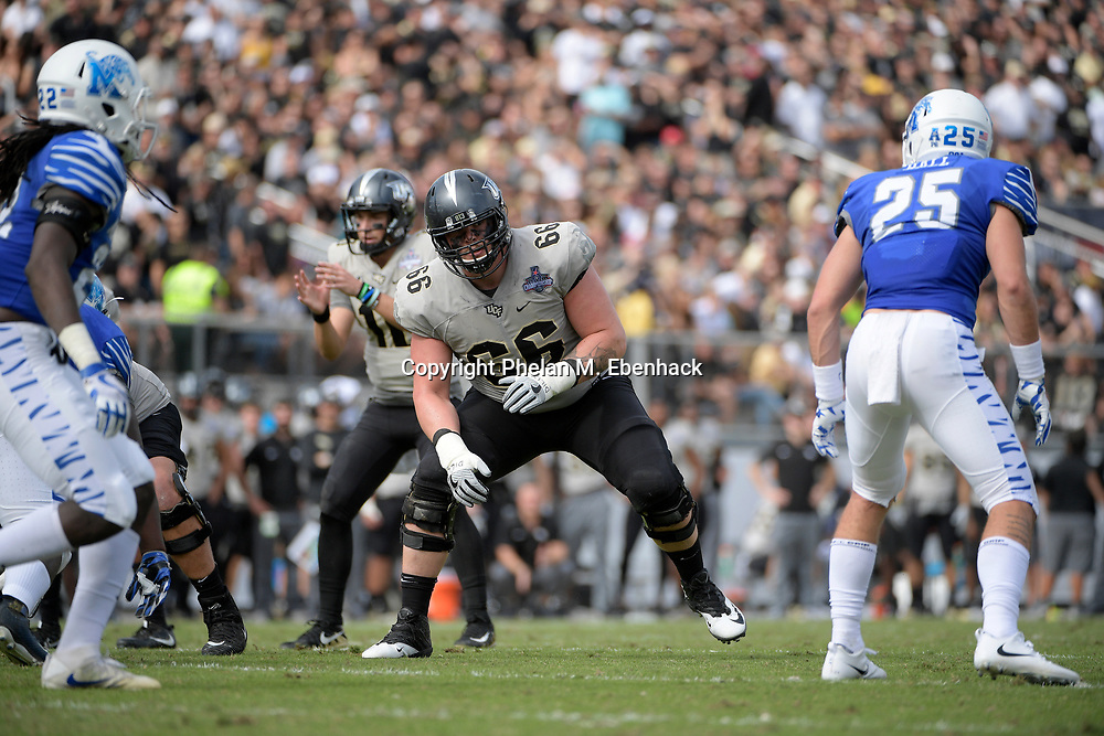 Central Florida offensive lineman Aaron Evans (66) sets up to block during the first half of the American Athletic Conference championship NCAA college football game against Memphis Saturday, Dec. 2, 2017, in Orlando, Fla. (Photo by Phelan M. Ebenhack)