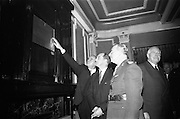 15/11/1966<br /> 11/15/1966<br /> 15 November 1966<br /> Unveiling of Commemorative Plaque for 53 anniversary of the decision to form the Irish Volunteers at Wynn's Hotel, Dublin. Picture shows Mr. George Colley T.D., Minister for Industry and Commerce, (centre) and Lieut. General Sean MacEoin (right) examine the plaque.