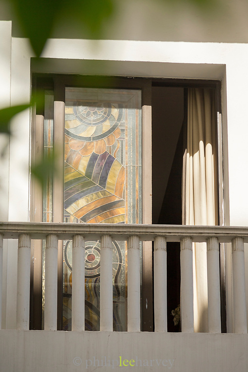 Architectural detail of a glass window and balcony railing in Casablanca, Morocco
