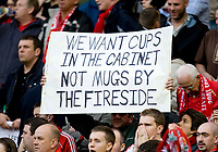 "LIVERPOOL, ENGLAND - Tuesday, April 22, 2008: Liverpool's fans hold up a banner saying ""We want cups in the cabinet, not mugs by the fireside"" as a reference to a Sky Sports interview with co-owner Tom Hicks, before the UEFA Champions League Semi-Final 1st Leg match against Chelsea at Anfield. (Photo by David Rawcliffe/Propaganda)"