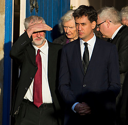 © Licensed to London News Pictures. 13/11/2015. London, UK. Current Labour party leader JEREMY CORBYN (left) and Former Labour party leader ED MILIBAND (right) after The funeral of former Labour MP Michael Meacher at St Mary's Church in Wimbledon, south west London.  Michael Meacher, who was a Labour MP in Oldham for over 40 years, served as Minister of State for the Environment in the Tony Blair government.  Photo credit: Ben Cawthra/LNP