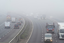 © Licensed to London News Pictures 03/03/2021. <br /> Swanley, UK. A cold foggy weather day for motorists on the M25 in Kent near Swanley. The Met Office has issued a misty fog warning for most of the day in the South East. Photo credit:Grant Falvey/LNP