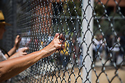 People listens speech from outside of the fence during Women's March Los Angeles Rally for Families Belong Together on Saturday, June 30th, 2018 at Downtown Los Angeles in California.