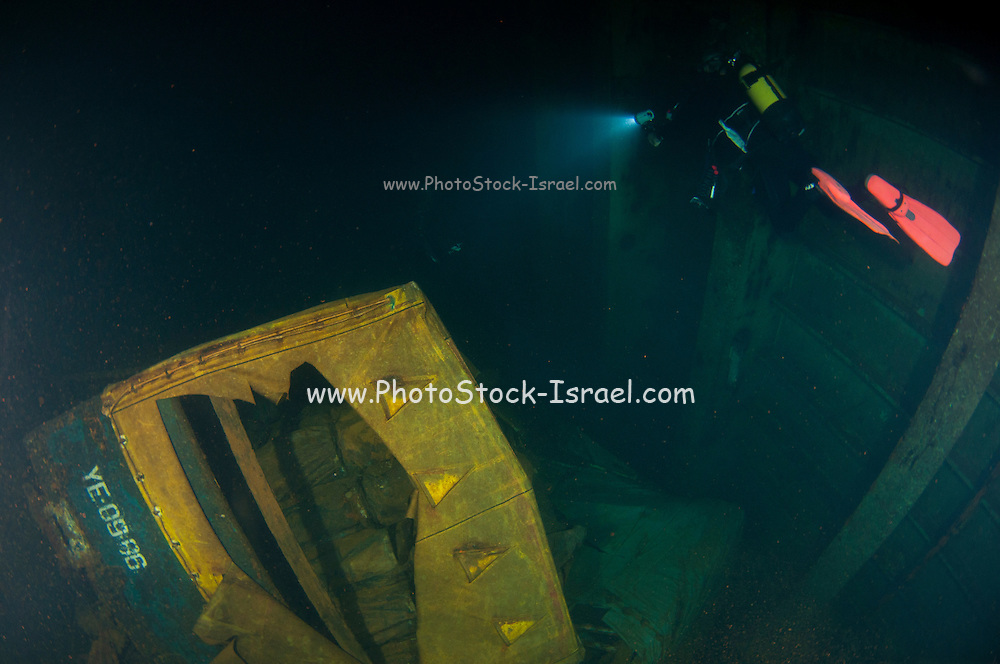 Diver at the MS Zenobia shipwreck. MS Zenobia was a Swedish built Challenger-class RO-RO ferry launched in 1979 that capsized and sank close to Larnaca, Cyprus, in June 1980 on her maiden voyage. She now rests on her port side in approximately 42 meters (138 ft) of water and was named as one of The Times top ten wreck diving sites in the world in 2003.