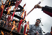 Chinese pilgrims burn candles and incense at the temple on the top of the Buddhist Sacred Mountain on Emei Shan  (Chinese: 峨眉山市 ; pinyin: Éméishānshì) in Emei, near Chengdu China, August 13, 2014.<br /> <br /> Confucianism, Taoism and Buddhism are the three major religions in China. Temples and statues witness their ancient roots all over the Chinese country.<br /> <br /> © Giorgio Perottino
