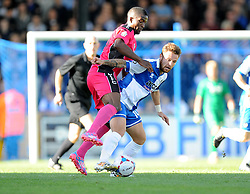 Bristol Rovers' Matt Taylor battles for the ball with Dover Athletic's Tyrone Sterling - Photo mandatory by-line: Alex James/JMP - Mobile: 07966 386802 - 04/10/2014 - SPORT - Football - Bristol - Stoke Gifford Stadium - Bristol Academy Womens v Notts County Ladies - Womens Super League