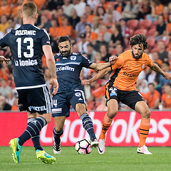 BRISBANE, AUSTRALIA - OCTOBER 7: Thomas Broich of the Roar and Fahid Ben Khalfallah of the Victory compete for the ball during the round 1 Hyundai A-League match between the Brisbane Roar and Melbourne Victory at Suncorp Stadium on October 7, 2016 in Brisbane, Australia. (Photo by Patrick Kearney/Brisbane Roar)
