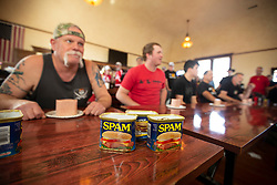 Contestants prepare to down an entire 12-ounce loaf of Spam at the 22nd annual Spam Festival, Sunday, Feb. 16, 2019, in Isleton, Calif. Spam lovers competed for prizes by presenting their favorite Spam-infused foods, or entering the Spam-eating and Spam-toss contests. (Photo by D. Ross Cameron)