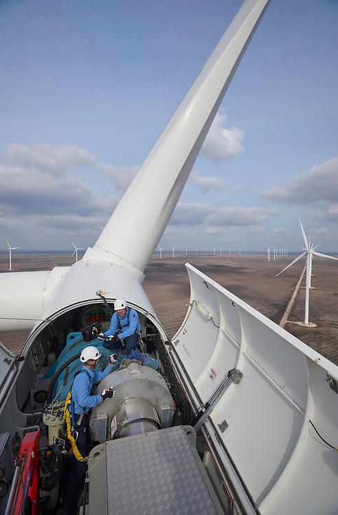Workers uptower in a Duke Energy Los Vientos Wind Farm, Texas