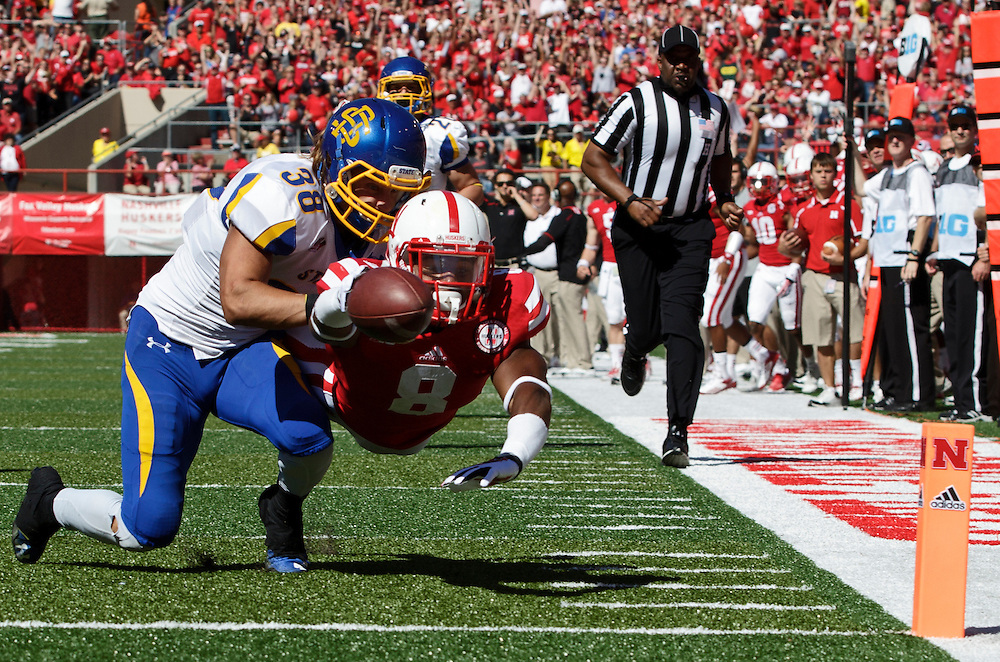 Nebraska running back Ameer Abdullah (8) stretches out but is stopped at the one yard line by South Dakota State defensive back Jake Gentile after a 28 yard reception from Tommy Armstrong with 13:58 left in the first quarter of Saturday's game at Memorial Stadium in Lincoln. Nebraska defeated South Dakota State 59-20. (Independent/Matt Dixon)