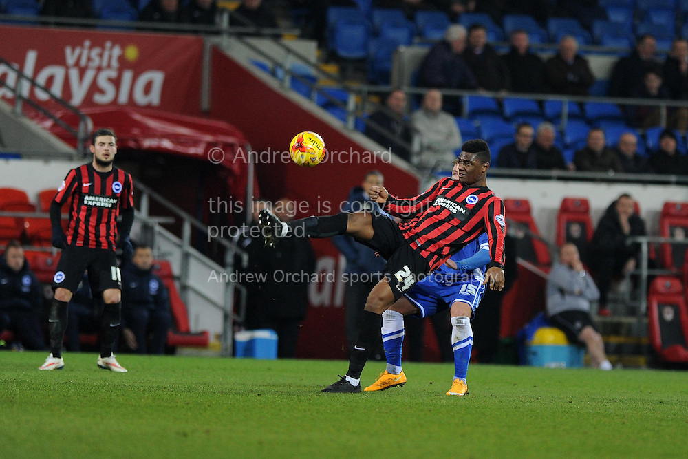 Brighton's Rohan Ince holds off Cardiff's Conor McAleny.  Skybet football league championship match, Cardiff city v Brighton & Hove Albion at the Cardiff city Stadium in Cardiff, South Wales on Tuesday 10th Feb 2015.<br /> pic by Andrew Orchard, Andrew Orchard sports photography.