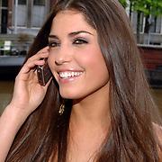 NLD/Amsterdam/20070515 - FHM verkiezing Meest Sexy vrouw van Nederland 2007, Yolanthe Cabau van Kasbergen word gebeld door Jan