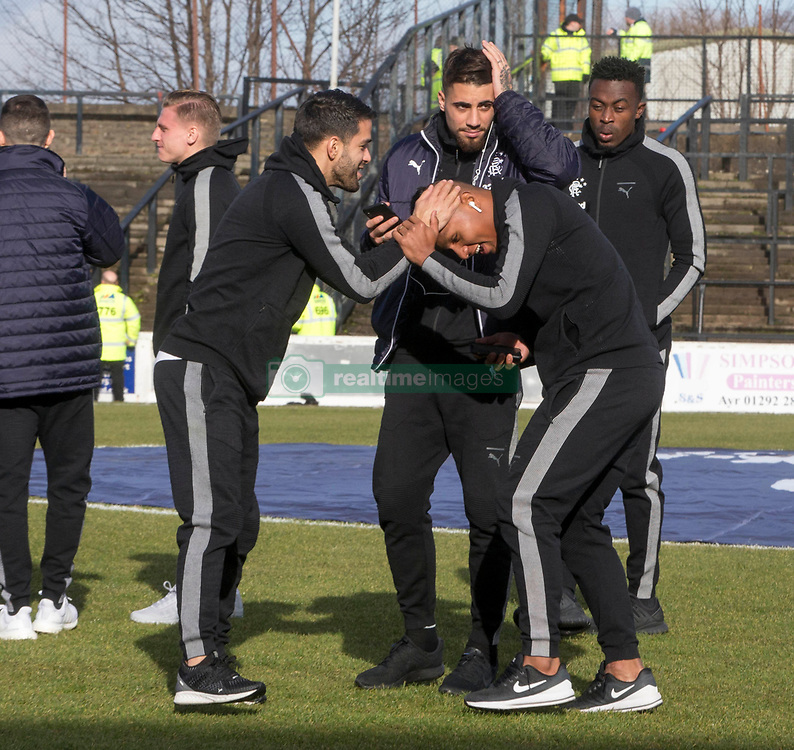 Rangers Alfredo Morelos (right) shares a joke with team-mates before the William Hill Scottish Cup, fifth round match at Somerset Park, Ayr.