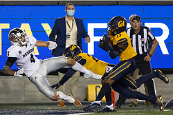California safety Miles Williams (13) intercepts a pass from Nevada quarterback Carson Strong intended for Nevada wide receiver Elijah Cooks (4) during the fourth quarter of an NCAA college football game, Saturday, Sept. 4, 2021, in Berkeley, Calif. (AP Photo/D. Ross Cameron)