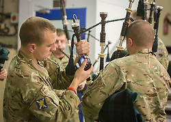 © Licensed to London News Pictures. 09/11/2013.  Members of 3rd Battalion (Black Watch) of the Royal Regiment of Scotland check the sounds levels of their bag pipes prior to taking part in a dress rehearsal this morning before the 2013 Festival of Remembrance.  Bands from the Army, Navy and the Royal Air Force will perform in front of Her Majesty The Queen.  Held in the Royal Albert Hall the service commemorates and honours all those who have lost their lives in conflicts.    Photo credit: Alison Baskerville/LNP