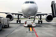 commercial passenger airplane being pushed away from the gate Toulouse France Blagnac